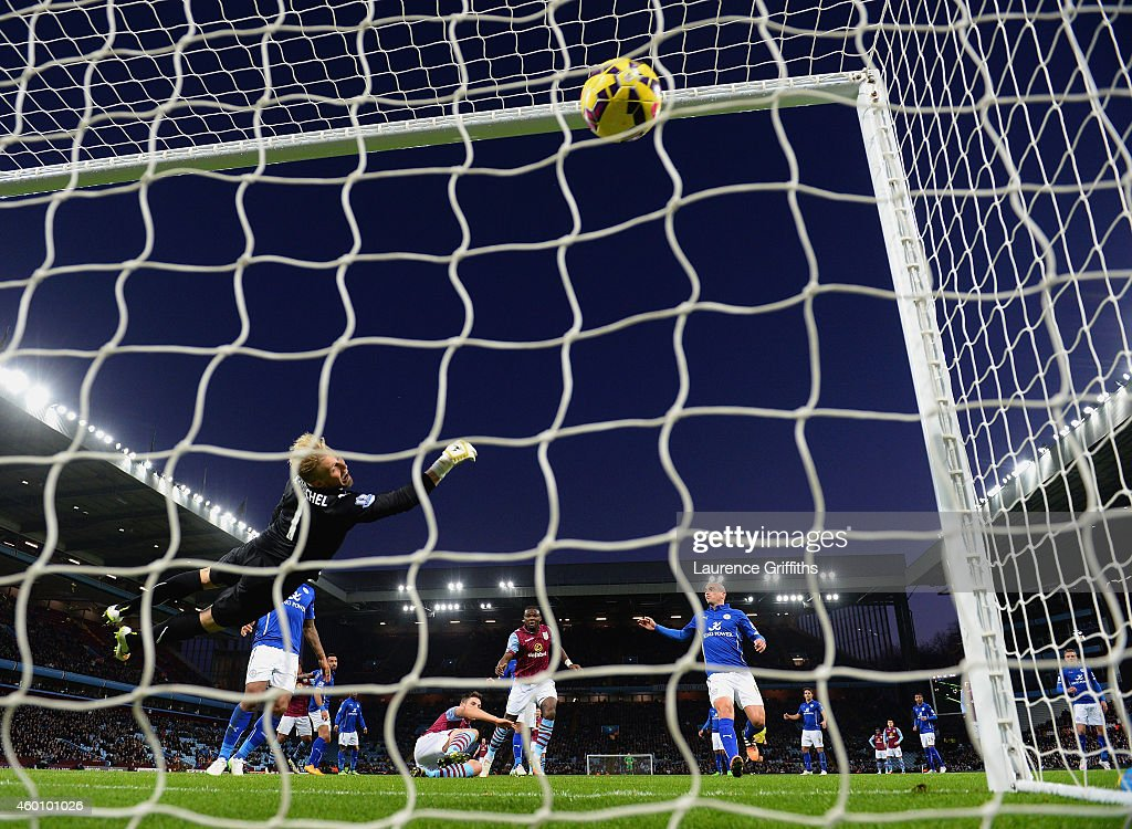 Ciaran Clark of Aston Villa scores their first goal past Kasper Schmeichel of Leicester City during the Barclays Premier League match between Aston Villa and Leicester City at Villa Park on December 7, 2014 in Birmingham, England.