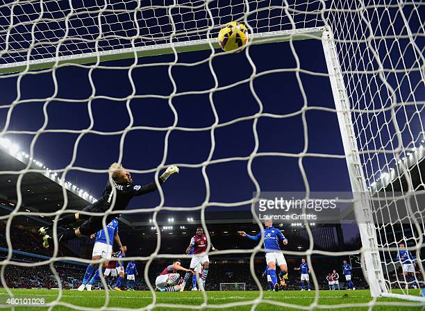 Ciaran Clark of Aston Villa scores their first goal past Kasper Schmeichel of Leicester City during the Barclays Premier League match between Aston...