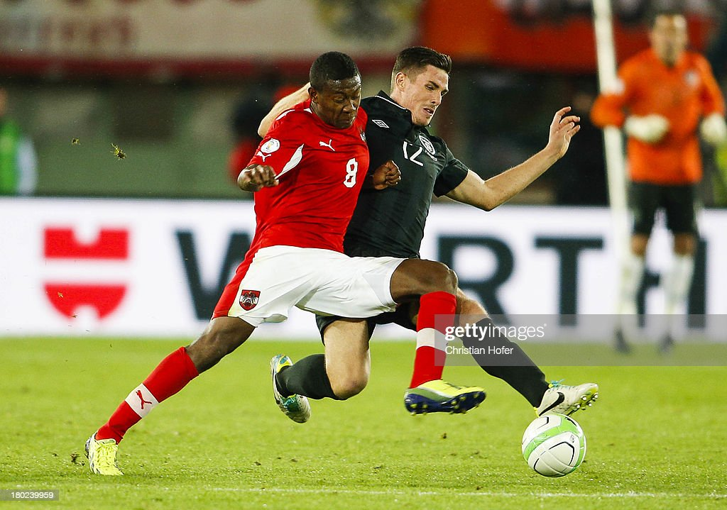 Ciaran Clark of Ireland (R) challenges David Alaba of Austria during the FIFA World Cup 2014 Group C qualification match between Austria and the Republic of Ireland at the Ernst Happel Stadium on September 10, 2013 in Vienna, Austria.