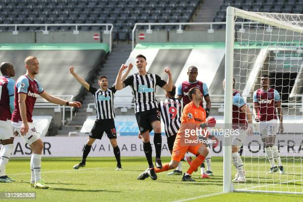 Ciaran Clark of Newcastle United celebrates after his teammate Joelinton scored their side's second goal during the Premier League match between...