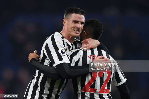 Ciaran Clark of Newcastle United celebrates after scoring his team's second goal with Deandre Yedlin during the Premier League match between Burnley...