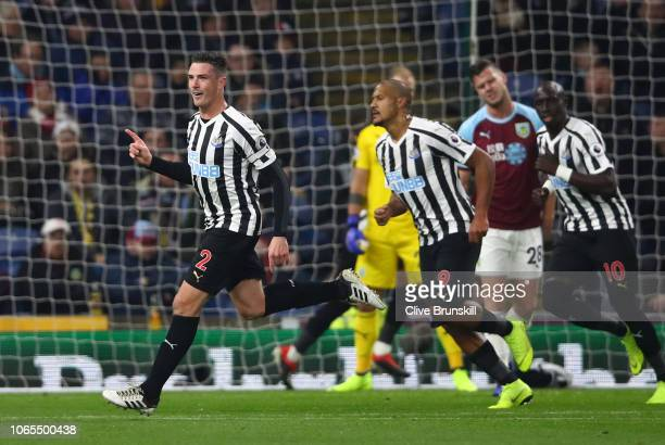 Ciaran Clark of Newcastle United celebrates after scoring his team's second goal with Salomon Rondon during the Premier League match between Burnley...