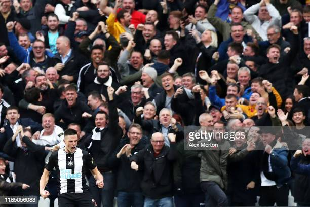 Ciaran Clark of Newcastle United celebrates after scoring his team's first goal during the Premier League match between West Ham United and Newcastle...