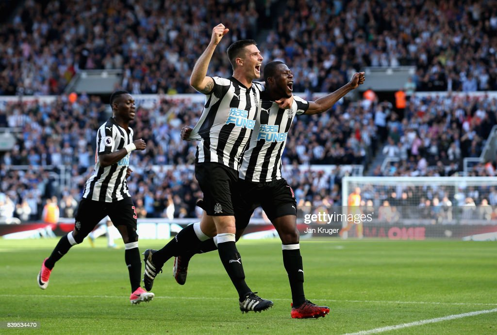 Ciaran Clark of Newcastle United celebrates scoring his sides second goal with Chancel Mbemba of Newcastle United during the Premier League match between Newcastle United and West Ham United at St. James Park on August 26, 2017 in Newcastle upon Tyne, England.