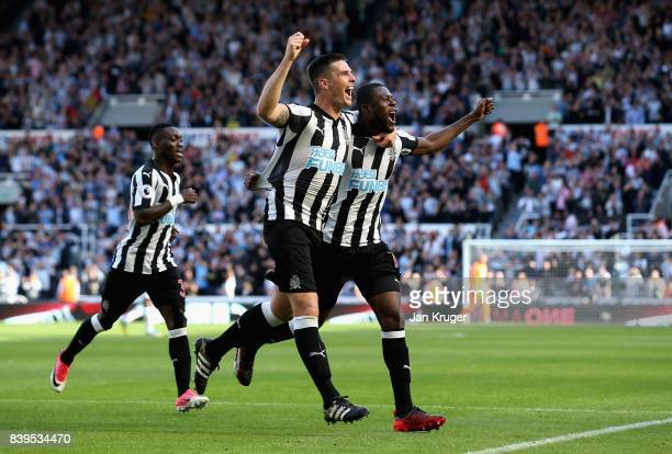 Ciaran Clark of Newcastle United celebrates scoring his sides second goal with Chancel Mbemba of Newcastle United during the Premier League match...
