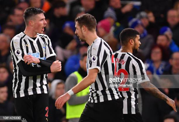 Ciaran Clark of Newcastle United celebrates with teammates after scoring his team's first goal during the Premier League match between Chelsea FC and...