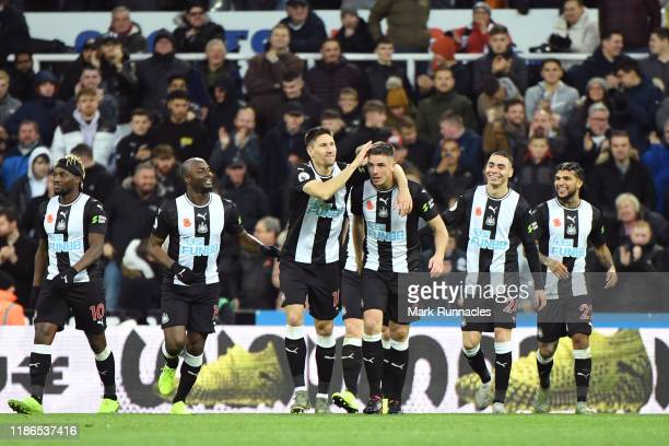 Ciaran Clark of Newcastle United celebrates with teammates after scoring his team's second goal during the Premier League match between Newcastle...