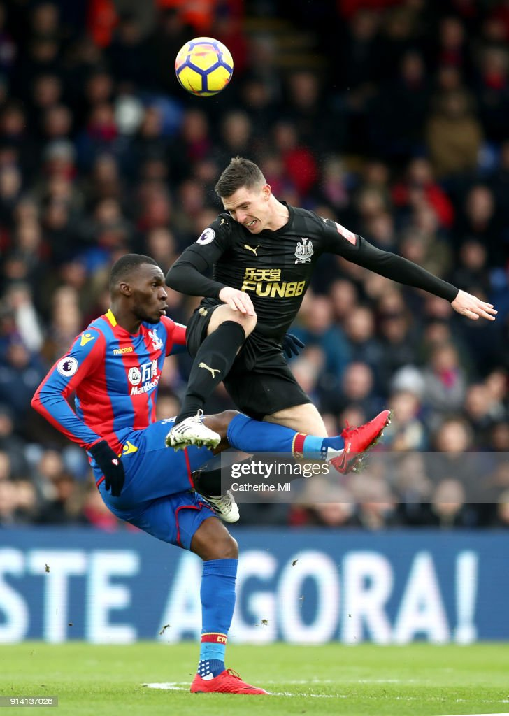 Ciaran Clark of Newcastle United challenges Christian Benteke of Crystal Palace during the Premier League match between Crystal Palace and Newcastle United at Selhurst Park on February 4, 2018 in London, England.