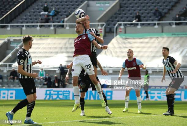 Ciaran Clark of Newcastle United commits a hand ball offence inside the penalty area, leading to West Ham United being awarded a penalty during the...