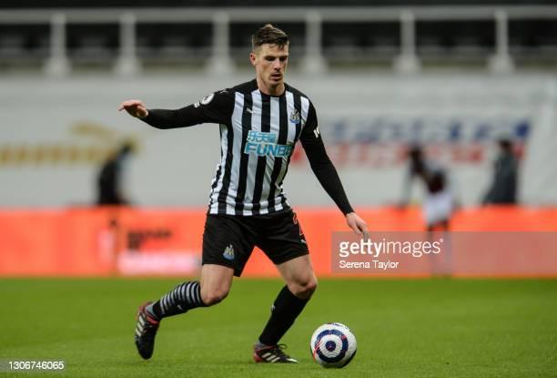 Ciaran Clark of Newcastle United FC controls the ball during the Premier League match between Newcastle United and Aston Villa at St. James Park on...