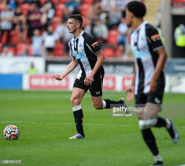 Ciaran Clark of Newcastle United FC runs with the ball during the Pre Season Friendly between Rotherham United and Newcastle United at AESSEAL New...