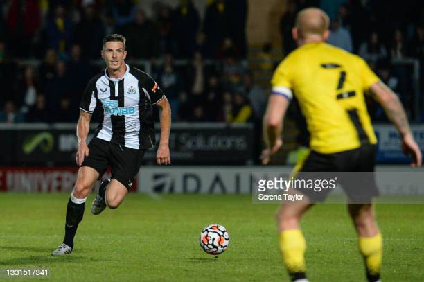 Ciaran Clark of Newcastle United FC runs with the ball during the Pre Season Friendly between Burton Albion and Newcastle United at the Pirelli...