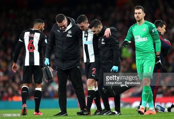 Ciaran Clark of Newcastle United gets injured during the Premier League match between Arsenal FC and Newcastle United at Emirates Stadium on February...