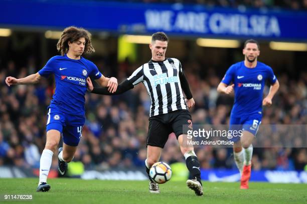 Ciaran Clark of Newcastle United in action with Ethan Ampadu and Danny Drinkwater of Chelsea during the FA Cup 4th Round match between Chelsea and...