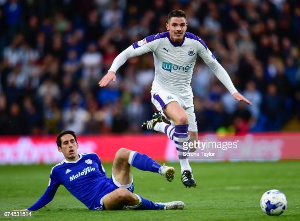 Ciaran Clark of Newcastle United jumps over Peter Whittingham of Cardiff City during the Sky Bet Championship match between Cardiff City and...