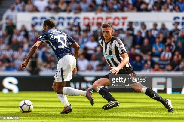 Ciaran Clark of Newcastle United looks to challenge Kyle WalkerPeters of Tottenham Hotspur during the Premier League Match between Newcastle United...