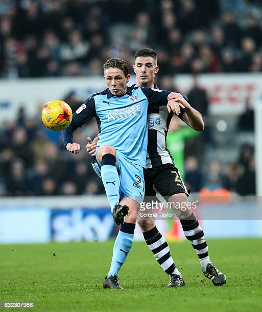 Ciaran Clark of Newcastle United puts pressure on Scott Allan of Rotherham United during the Sky Bet Championship match between Newcastle United and...