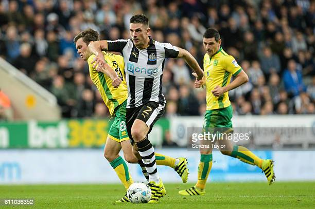 Ciaran Clark of Newcastle United runs with the ball and is fouled by Jonny Howson of Norwich City during the Sky Bet Championship match between...