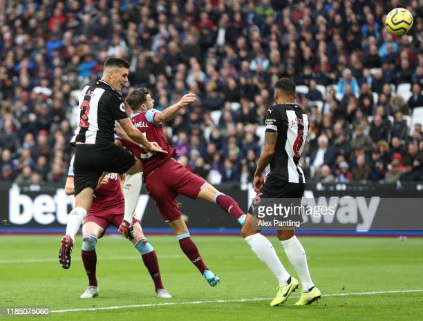 Ciaran Clark of Newcastle United scores his sides first goal during the Premier League match between West Ham United and Newcastle United at London...