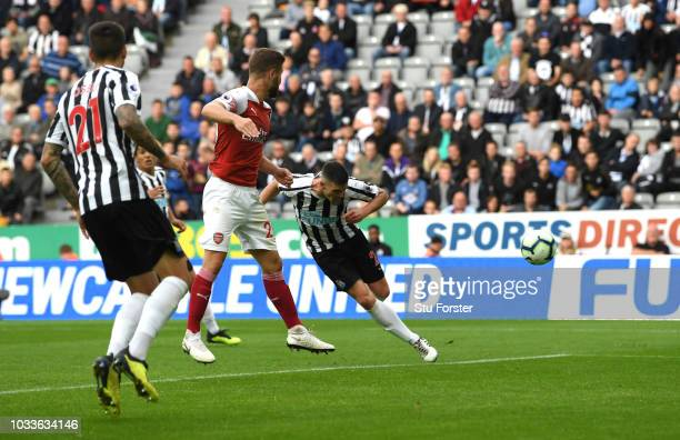 Ciaran Clark of Newcastle United scores his team's first goal during the Premier League match between Newcastle United and Arsenal FC at St James...