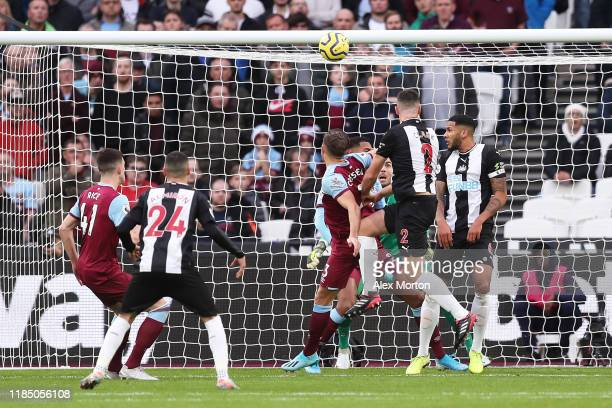 Ciaran Clark of Newcastle United scores his team's first goal during the Premier League match between West Ham United and Newcastle United at London...