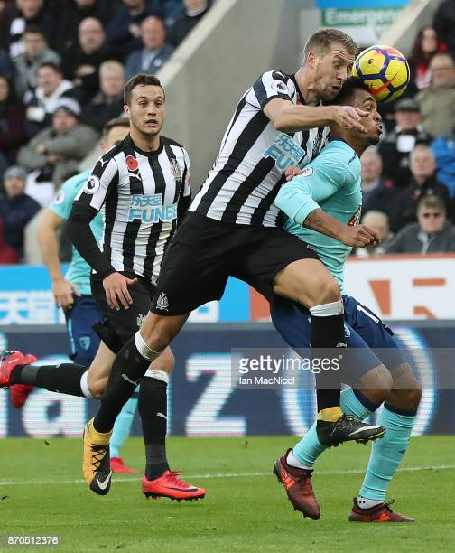 Ciaran Clark of Newcastle United vies with Joshua King of Bournemouth during the Premier League match between Newcastle United and AFC Bournemouth at...