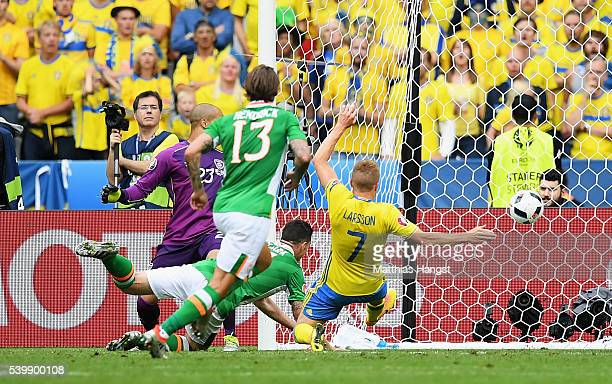 Ciaran Clark of Republic of Ireland heads the ball to score the own goal during the UEFA EURO 2016 Group E match between Republic of Ireland and...