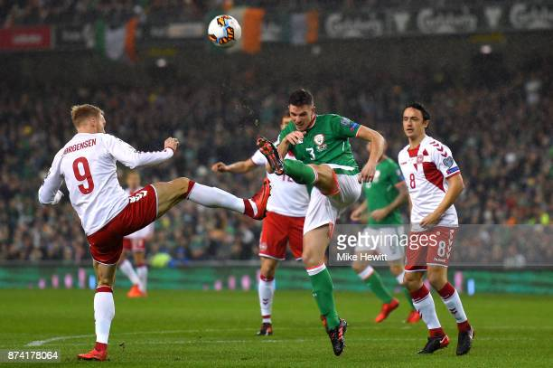 Ciaran Clark of the Republic of Ireland and Nicolai Jorgensen of Denmark battle for possession during the FIFA 2018 World Cup Qualifier PlayOff...