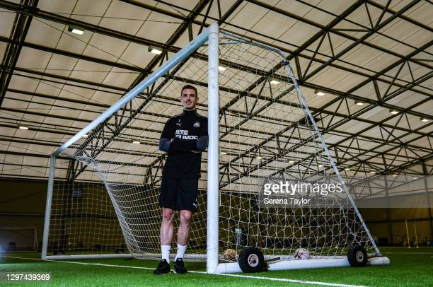Ciaran Clark poses for a photograph next to a goal after signing a new contract at the Newcastle United Training Centre on January 20, 2021 in...