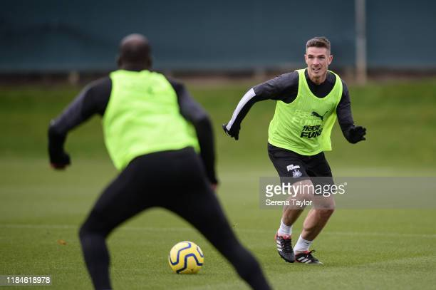 Ciaran Clark runs with the ball during the Newcastle United Training Session at the Newcastle United Training Centre on October 31, 2019 in Newcastle...