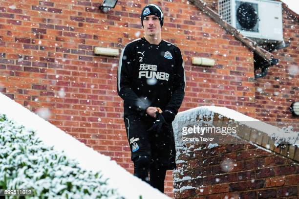 Ciaran Clark smiles in the snow during the Newcastle United Training session at the Newcastle United Training Centre on December 29 in Newcastle upon...