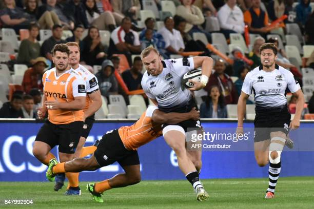 Ciaran Gaffney of Zebre is tackled by Sergeal Petersen of the Cheetahs during the Guinness Pro14 rugby match at Bloemfontein rugby stadium in...