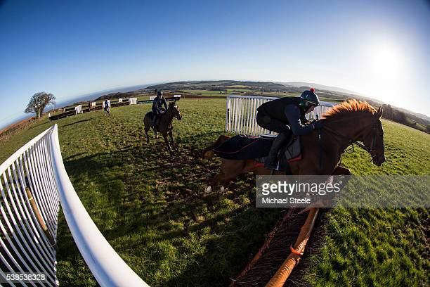Ciaran Gethings clears a hurdle on Free of Charge during a schooling session on the upper schooling grounds at Sandhill Racing Stables on March 10...