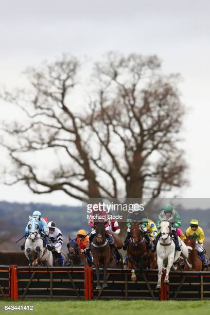 Ciaran Gethings on All But Grey alongside Miss B Frost on Gilly Grace and Nico de Boinville on Just When clear the first hurdle during the King's...