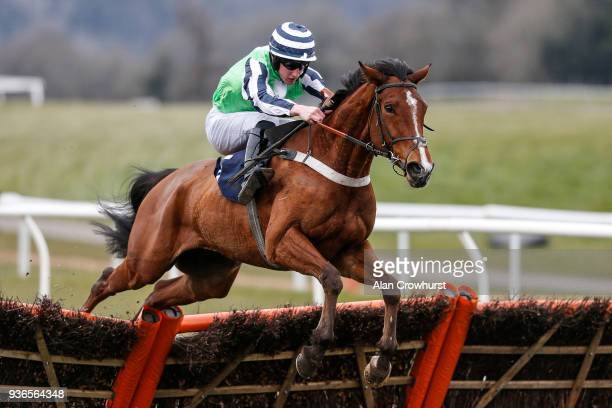 Ciaran Gethings riding Heluvagood clear the last to win The ECIC Novices' Handicap Hurdle Race at Chepstow racecourse on March 22 2018 in Chepstow...