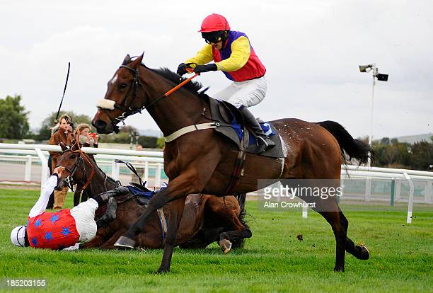 Ciaran Gethings riding Oscar Davy falls at the last in The Fie Country North Cotswolds Amateur Riders' Handicap Steeple Chase at Cheltenham...