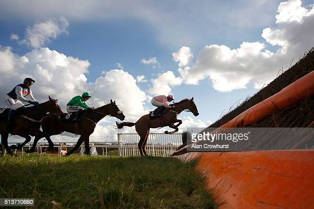 Ciaran Gethings riding Ut majeur Aulmes clear the last to win The Berry Bros Rudd Handicap Steeple Chase at Newbury racecourse on March 04 2016 in...