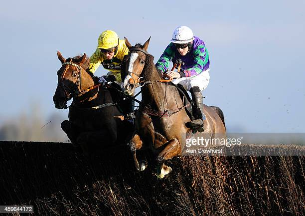 Ciaran Gethings riding Woodford County clear the last to win The Burges Salmon Amateur Riders' Handicap Steeple Chase at Newbury racecourse on...