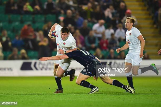 Ciaran Knight of England U20 is tackled by Cameron Hutchison of Scotland U20 during the Under 20s Six Nations Rugby match between England U20 and...