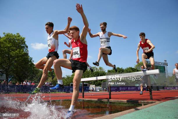 Ciaran Lewis of Wales and Daniel Jarvis of England clear the water jump alongside each other during the Men's 3000m Steeple Chase at the Loughborough...