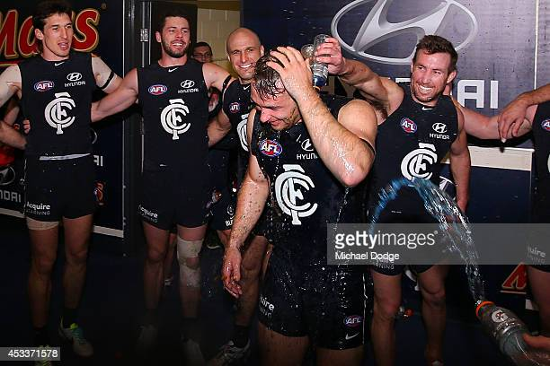 Ciaran Sheehan of the Blues celebrates his debut game with a win and a dousing of Gatorade during the round 20 AFL match between the Carlton Blues...