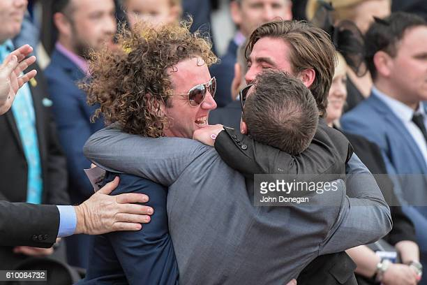 Ciaron Maher celebrates with connections after Bon Aurum ridden by Kerrin McEvoy won Yulong Park Sir Rupert Clarke Stakes at Caulfield Racecourse on...