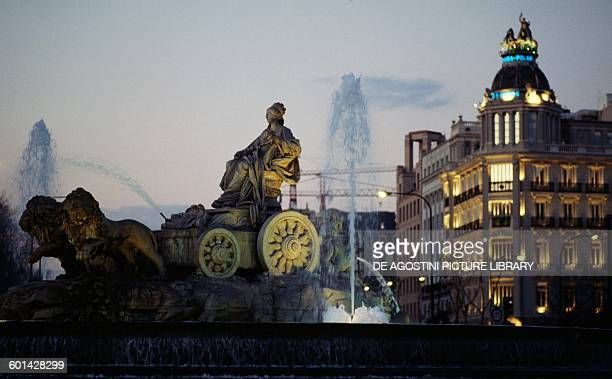 Cibeles fountain 17th century in the square of the same name by night Madrid Spain
