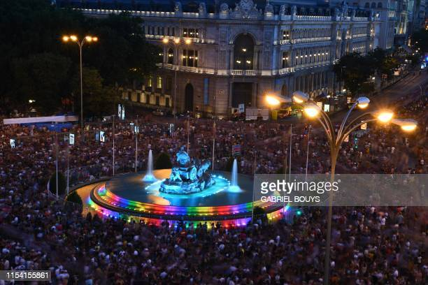 Cibeles fountain is illuminated with the colors of the rainbow flag during the annual Pride parade in Madrid on July 6 2019