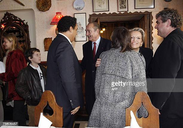 French President Jacques Chirac looks at his grandson Martin ReyChirac prior to a lunch with Defense minister Michele Alliot Marie former Rugby...