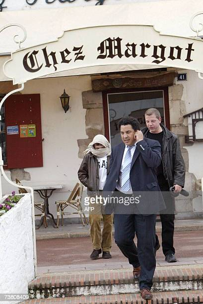 French President Jacques Chirac's grandson Martin ReyChirac leaves 03 April 2007 with former rugby player Serge Blanco and a bodyguard the 'Chez...