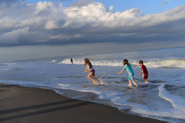 DE: Families Spend Thanksgiving Day On The Beach In Delaware
