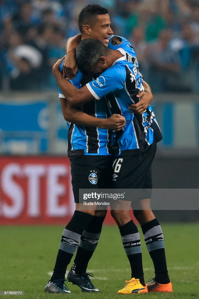 Cicero (L) and Leo Moura of Gremio celebrate the victory against Lanus after the first leg match between Gremio and Lanus as part of Copa Bridgestone Libertadores 2017 Final at Arena do Gremio on November 22, 2017 in Porto Alegre, Brazil.