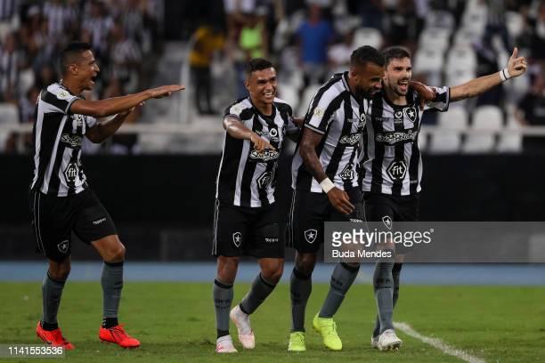 Cicero Erik Alex Santana and Rodrigo Pimpao of Botafogo celebrate a scored goal against Fortaleza during a match between Botafogo and Fortaleza as...