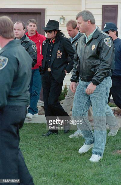 Michael Jackson leaves the late Ryan White's house surrounded by police Jackson spent a few hours at Jeanne White's home The singer befriended Ryan...